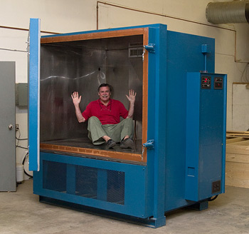 Senior Electrical Research Engineer Tom Cumberland in the newest additions to Axiom's testing regimen is a special temperature and humidity chamber.